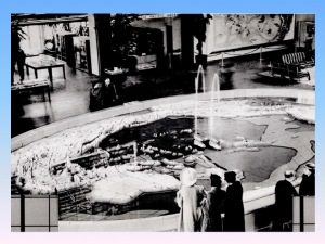 Pacific Basin Fountain in main lobby of Pacific House, 1939--note spouting whales in center of fountain and Covarrubias miural at the top right of photo