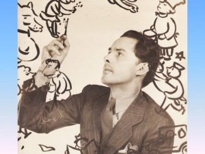 Photo of Antonio Sotomayor painting caricatures (brush is on his wife, Grace)